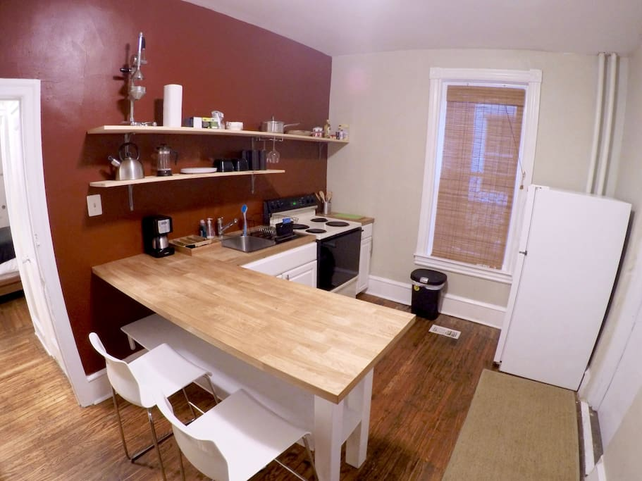 Cute, clean, simple kitchen with peninsula / bar / breakfast nook