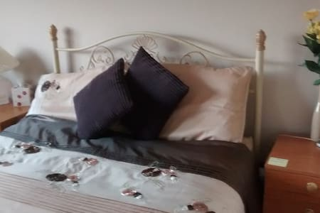 We're renting out the master bedroom upstairs. It has a double bed and an attached bathroom. There is a bus stop about a three minute walk from the house. The bus takes you to the city centre in 25 minutes. We are close to Dublin airport (17Kms)