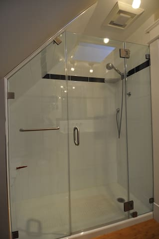 Walk-in shower with awesome water pressure.
