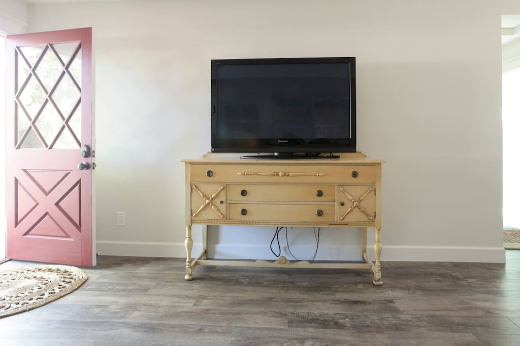 50-inch television with Apple TV and Roku Streaming