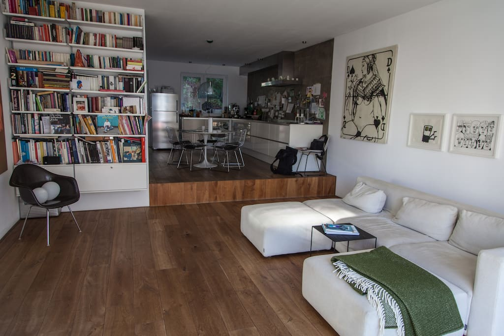 The living room with open kitchen. You have direct access to the terrasse.