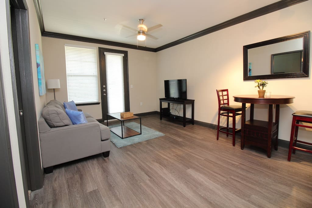 Living room area with 105+ MBPS Wi-Fi Cable Internet and 140+ channels premium cable and local TV channels