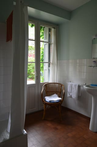 The spacious shower room looks onto the garden too, with more double doors and shutters so that you can keep the room well ventilated and secure when you go out.