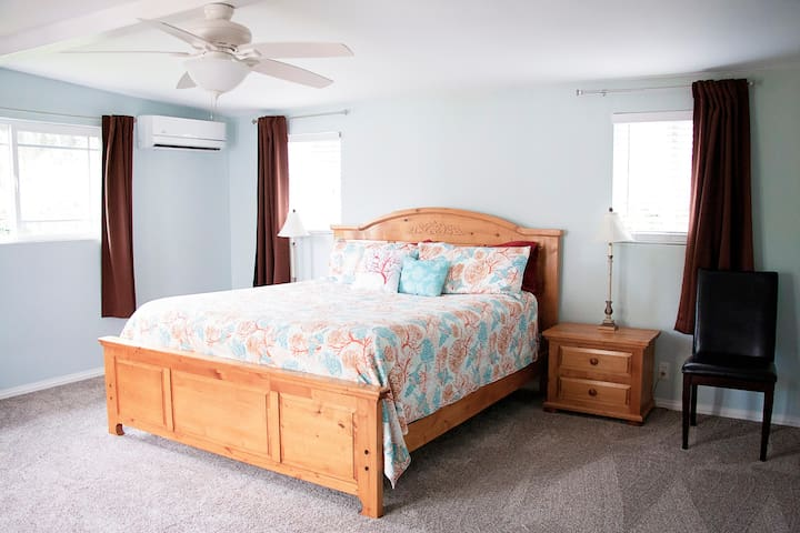 extra large master bedroom, king bed, dresser and desk with plenty of room to add a crib and rocking chair if you need it