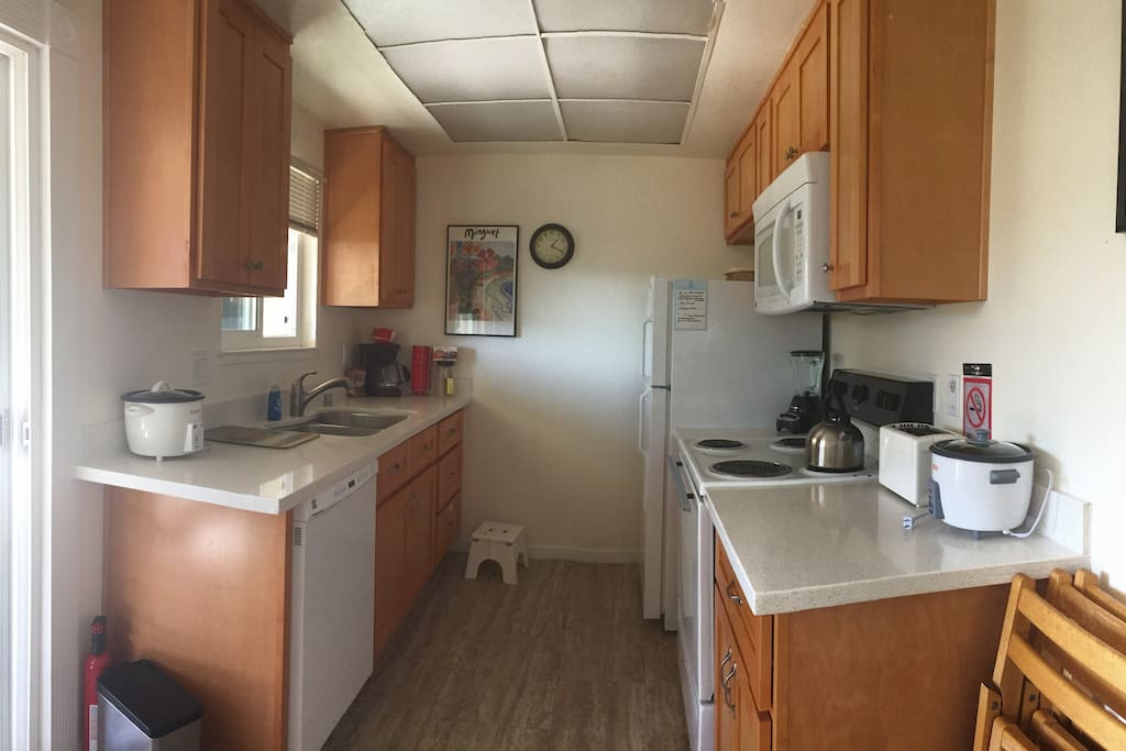 Sunny Kitchen:   Full kitchen complete with 4-burner stove, full-sized oven, microwave oven, rice cookers, toaster, blender, coffee maker, cooking pots & pans, dishes, utensils and dishwasher.
