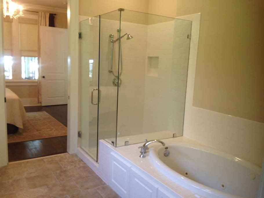 Renovated jetted garden tub and new seamless shower with new subway tile