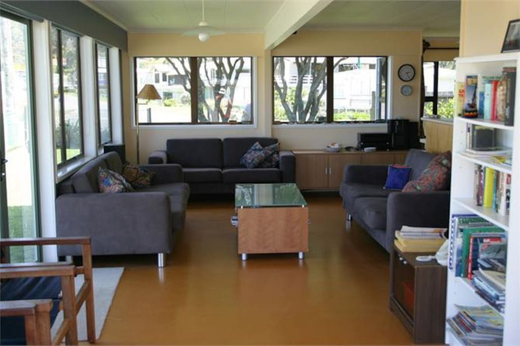 3 sofas and plenty of extra seating to relax in