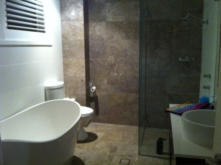 bathroom with bath, shower and toilet, this is usually a shared space.