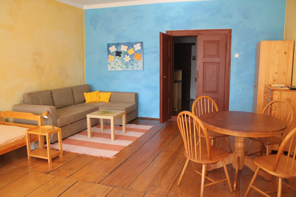 Wooden floor and the door are original ones more than 100 years old. The new and comfortable furniture from massive wood goes along with the rustic style of the house.