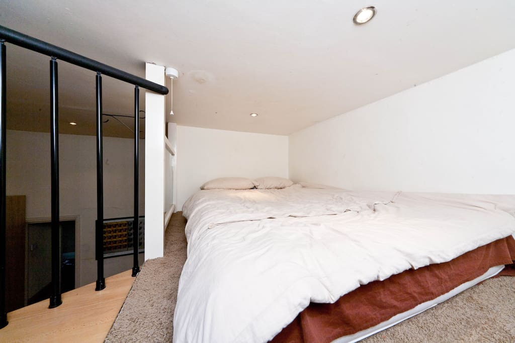 Double bed in mezzanine with low ceiling