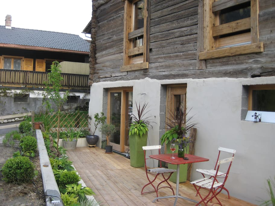 Patio and entrance in the summer.