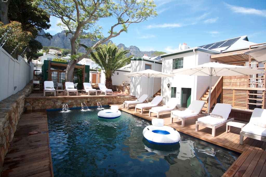 The communal solar heated pool with loungers