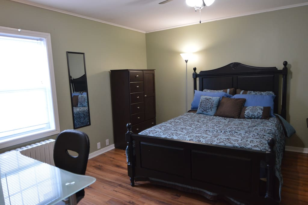 Master bedroom has lots of storage and a workdesk with lamp.