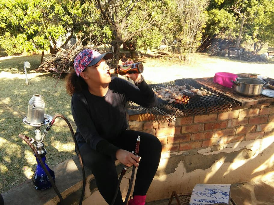 """Sip on a cold one while you get some meat on the """"braai"""""""