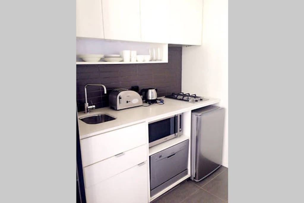 Equipped with all  appliances for daily use,microwave, fridge, kettle,toaster,gas stove, pots and pan, cutlery