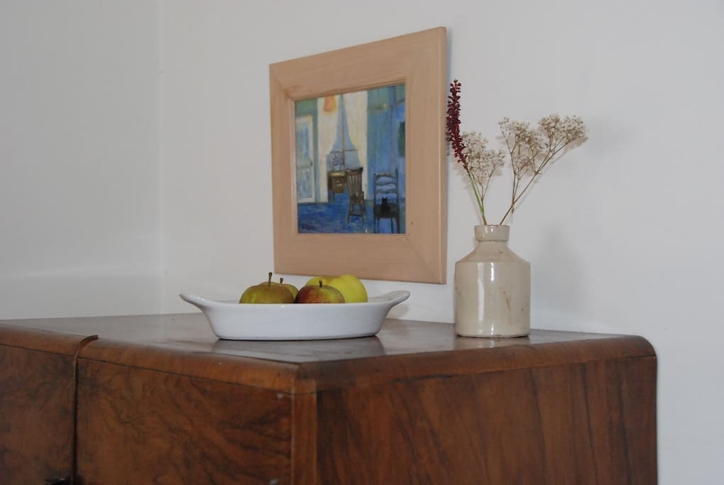 Fruit bowl and fresh flowers in bedroom