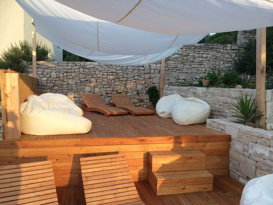 Do yoga at the wonderful wooden terrace with the view to the rising sun