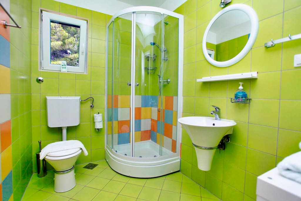 Colorful bathroom with shower.