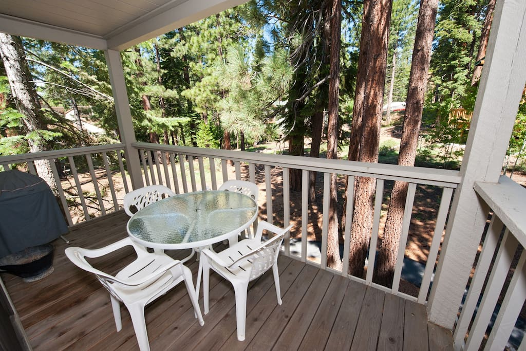 Deck off Living room, view of trees surrounding complex