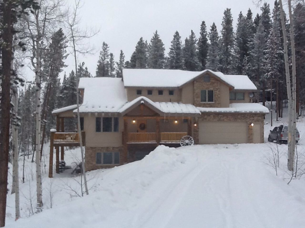 Beautiful home, wooded surroundings and wildlife, but cozy on 2 acres. Ample parking for 2-3 cars, and private deck with hot tub. Heated garage!