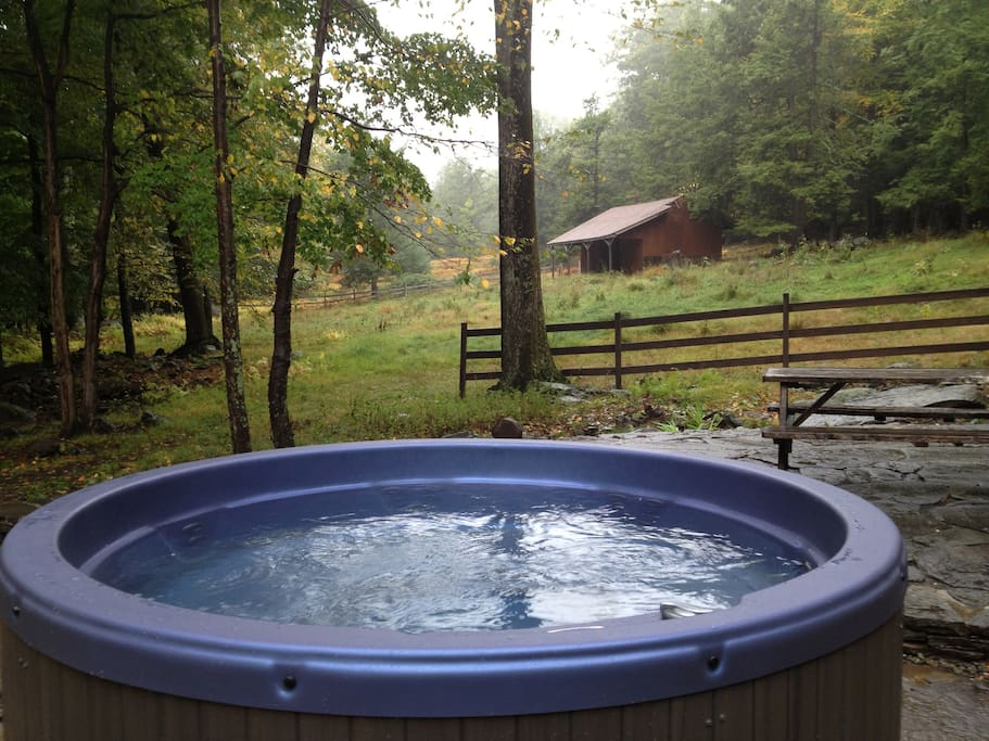 A new  outdoor hot tub, nature as its best