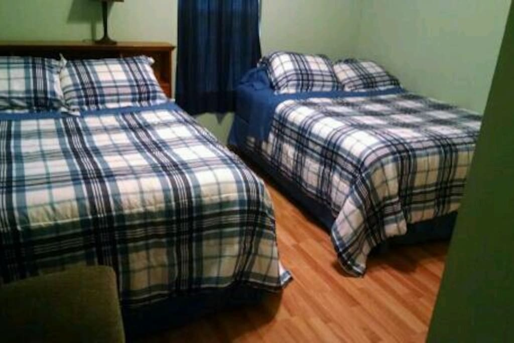 Two full sized beds with top quality mattresses and new bedding. Great room for sharing when traveling on a budget!