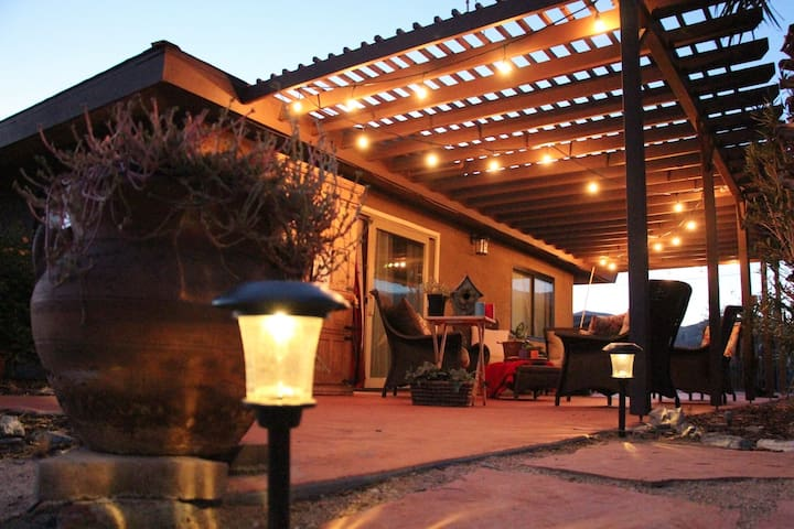 Sink into the deep cushioned patio furniture to watch the moon rise over the eastern Little San Bernardino Mountains. Cafe string lights give a beautiful glow for dinner al fresco, or turn them off for stunning stargazing!