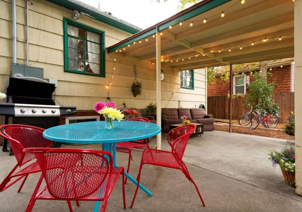 Backyard with outdoor seating area, vegetable and herb garden, BBQ and firepit. Occasionally shared with guests in other unit.