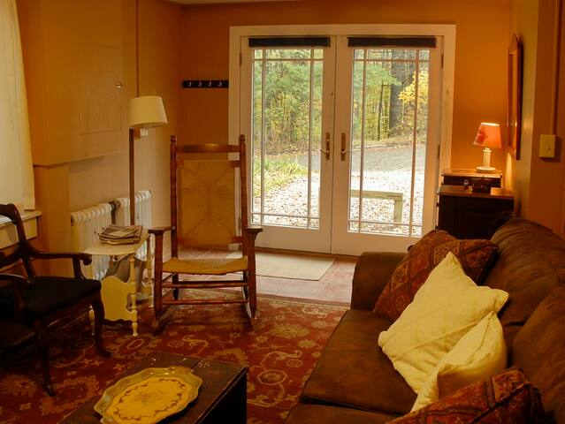 Another view of the living room, showing the French doors which are the main entrance.