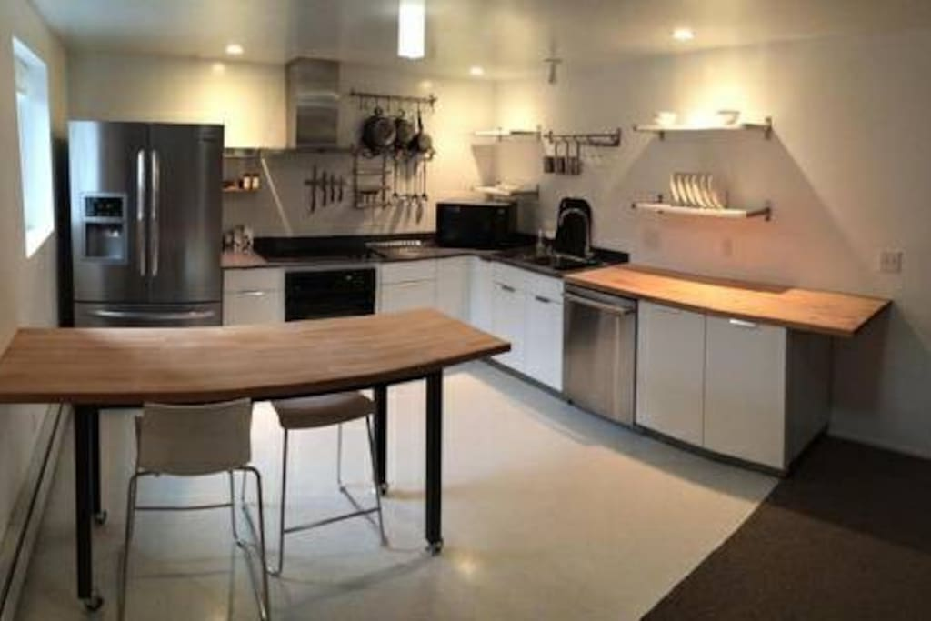 Fully stocked open-concept kitchen for all your dining/entertainment needs.