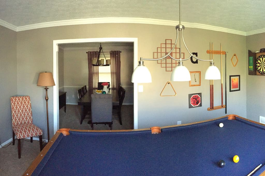 Game room: 8' pool table and steel-tip dart board.