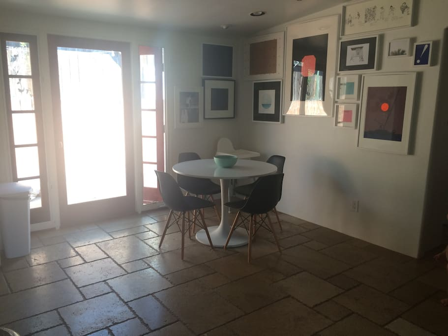 Dining area with side door to our outdoor galley way with outdoor shower