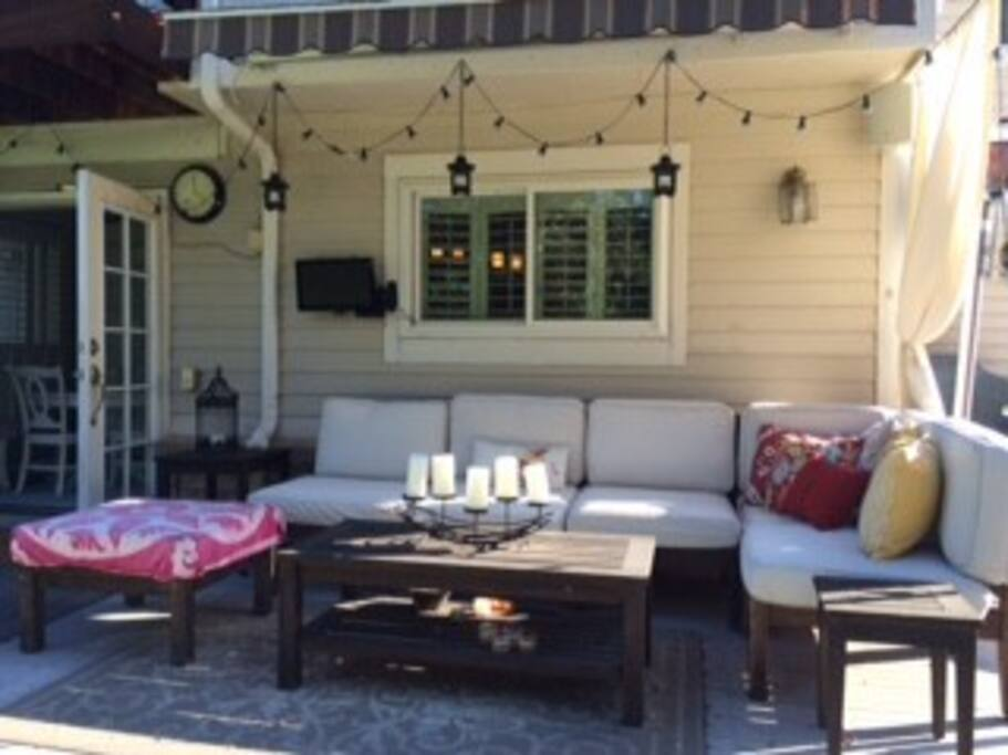 Outdoor living room with pottery barn sofa, bar, TV.  great entertaining!