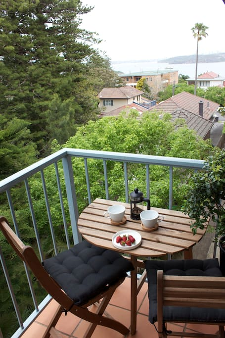 Enjoy your own private balcony nestled among the pine trees.