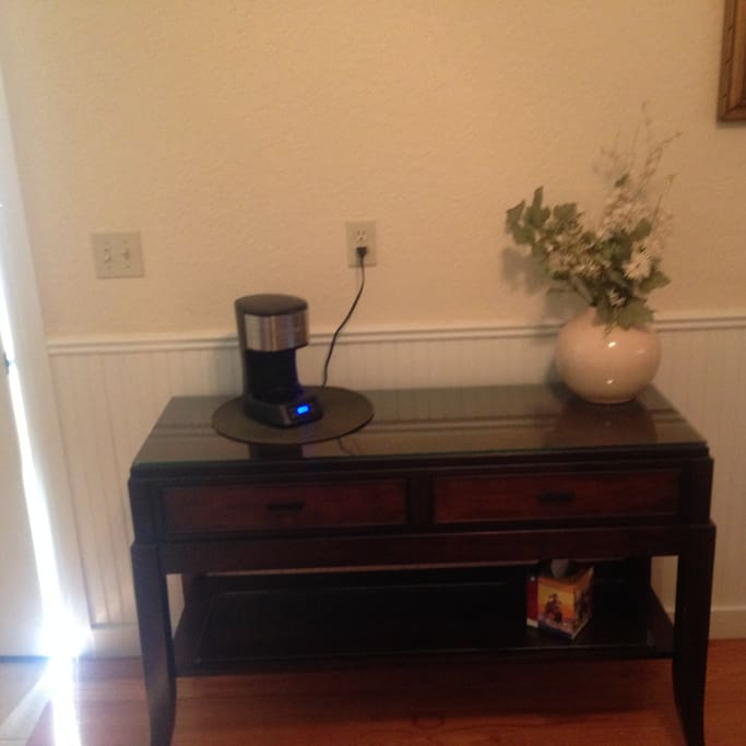 Coffee maker, small refrigerator and microwave.