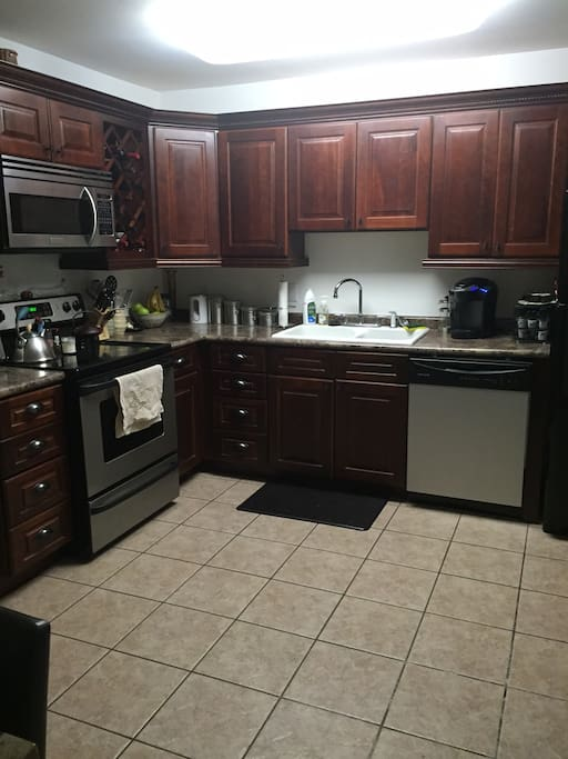 Spacious kitchen available for use, microwave, oven, fridge (BYOB), and Keurig. There is also a laundry room available for use for guests.