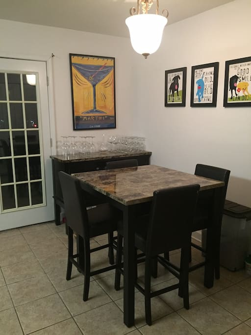Dining table in eat-in kitchen with patio access.