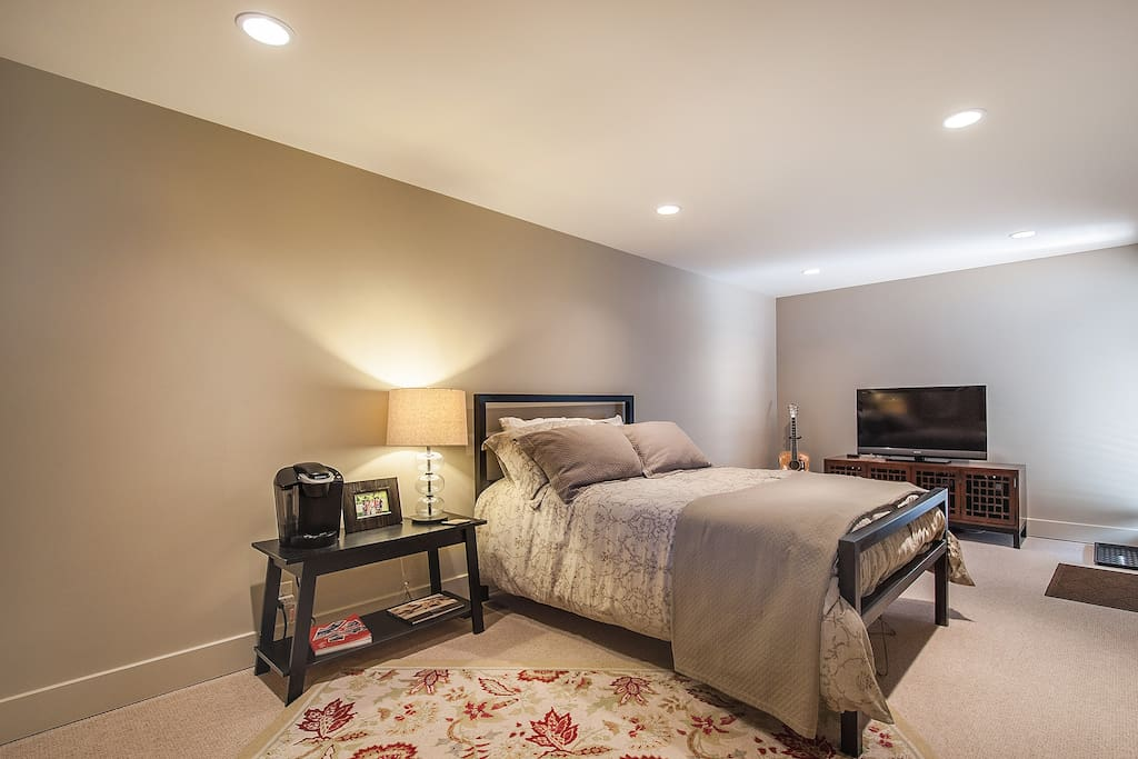 Huge suite with private entrance and bathroom. Double bed from Room & Board with Restoration Hardware linens, Keurig, and Sony fat-screen HDTV.