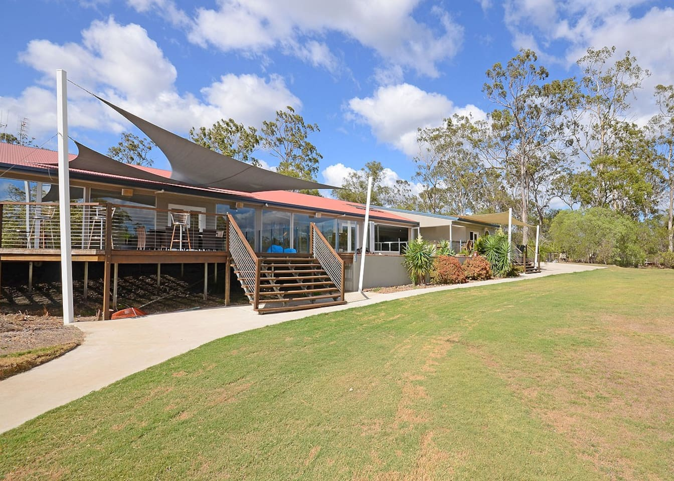 Large Entertaining Deck over looking the River  House facing river.  Lawns for out door games.