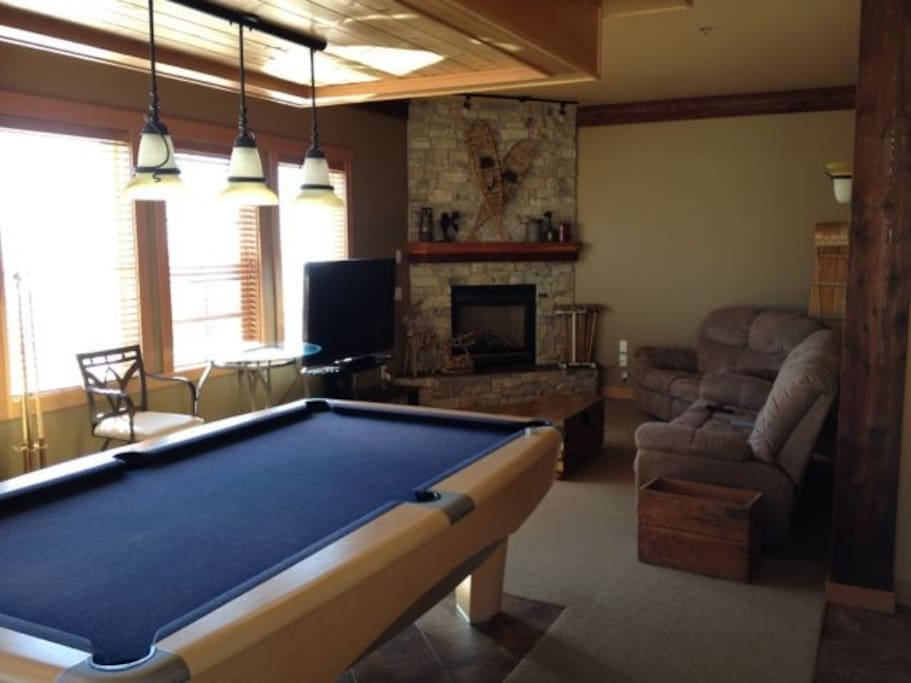 Games and TV room with apple TV, pool table, comfy reclining couches, fridge and gorgeous mountain view