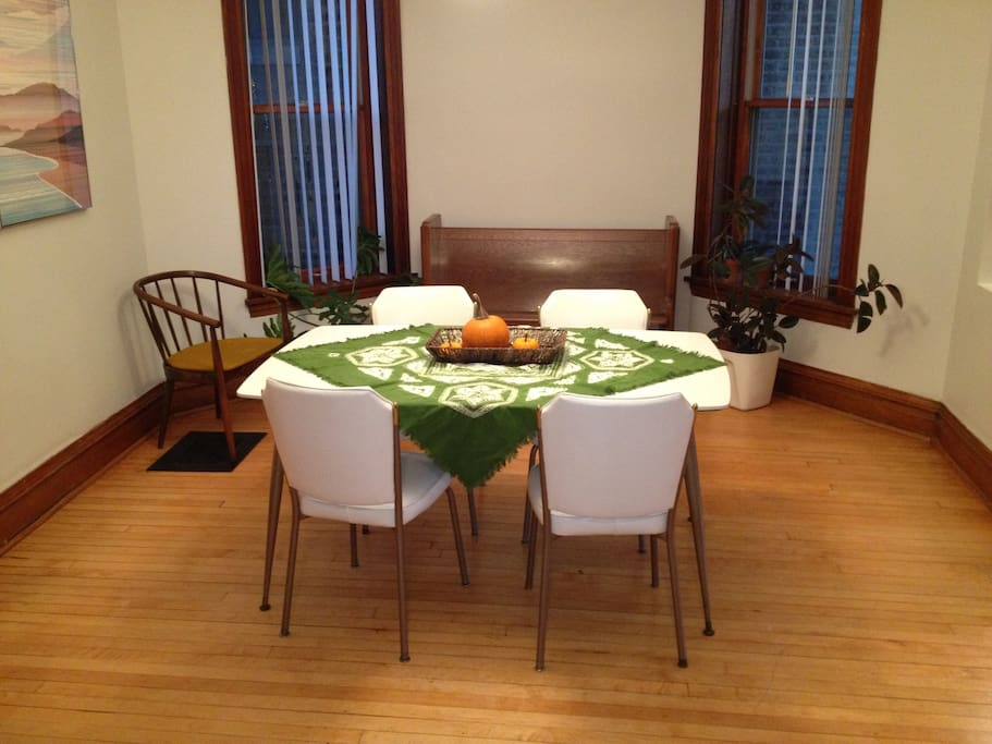 Spacious dining room with seating for six.