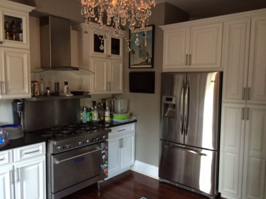 Kitchen with commercial grade gas range, granite, French Door refrigerator, dishwashers.
