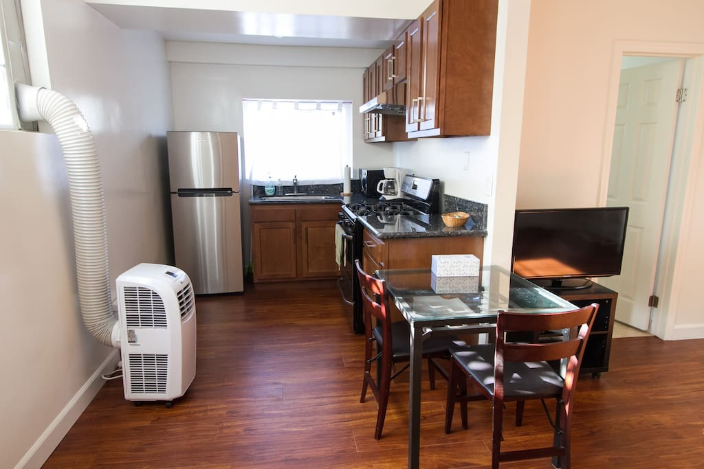 Kitchen and dining area with A/C unit for living room