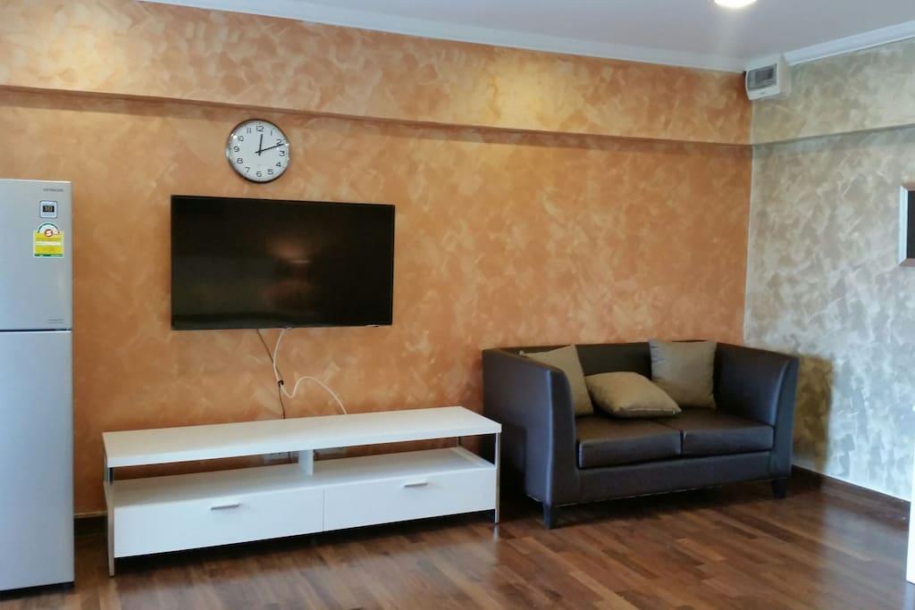 TV 48 inch, sofa, dining table, fridge.