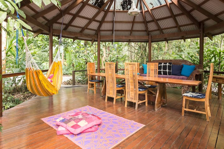 Relax on a daybed, swing in a hammock or have dinner in the gazebo listening to the sounds of the forest