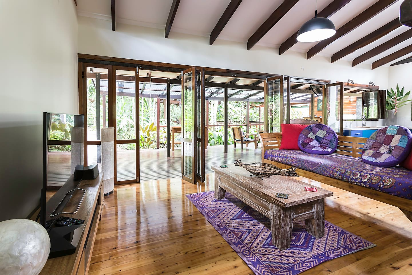 A rainforest wilderness - 2 bedroom sun drenched eco-house on a rare exotic fruit orchard with 5 acres of world heritage rainforest