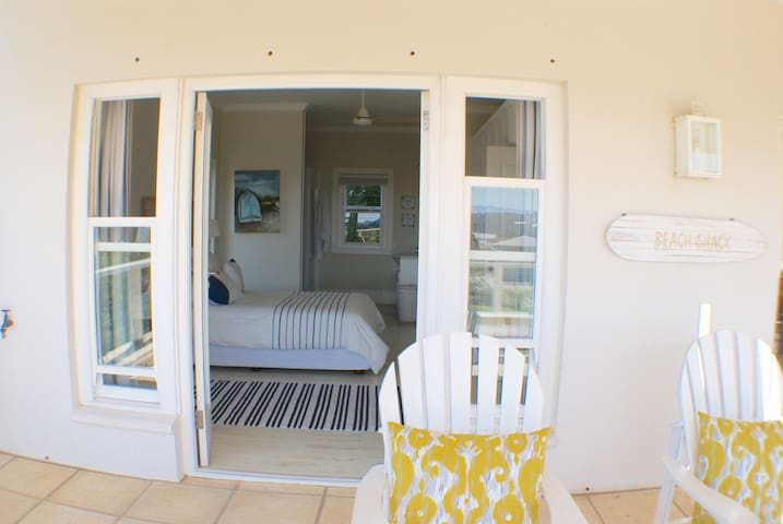 Bedroom 2. Queen size bed. En suite bathroom leading out to large patio with great views