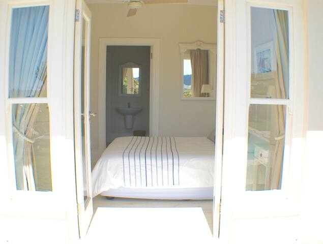 Bedroom 3 with queen size bed leading out onto the pool