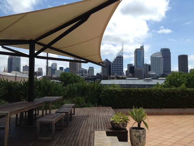 Rooftop terrace with view on the water, wharf and city