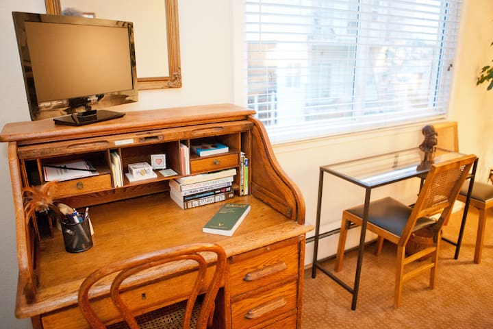 You have writing desk, computer desk and television in your room